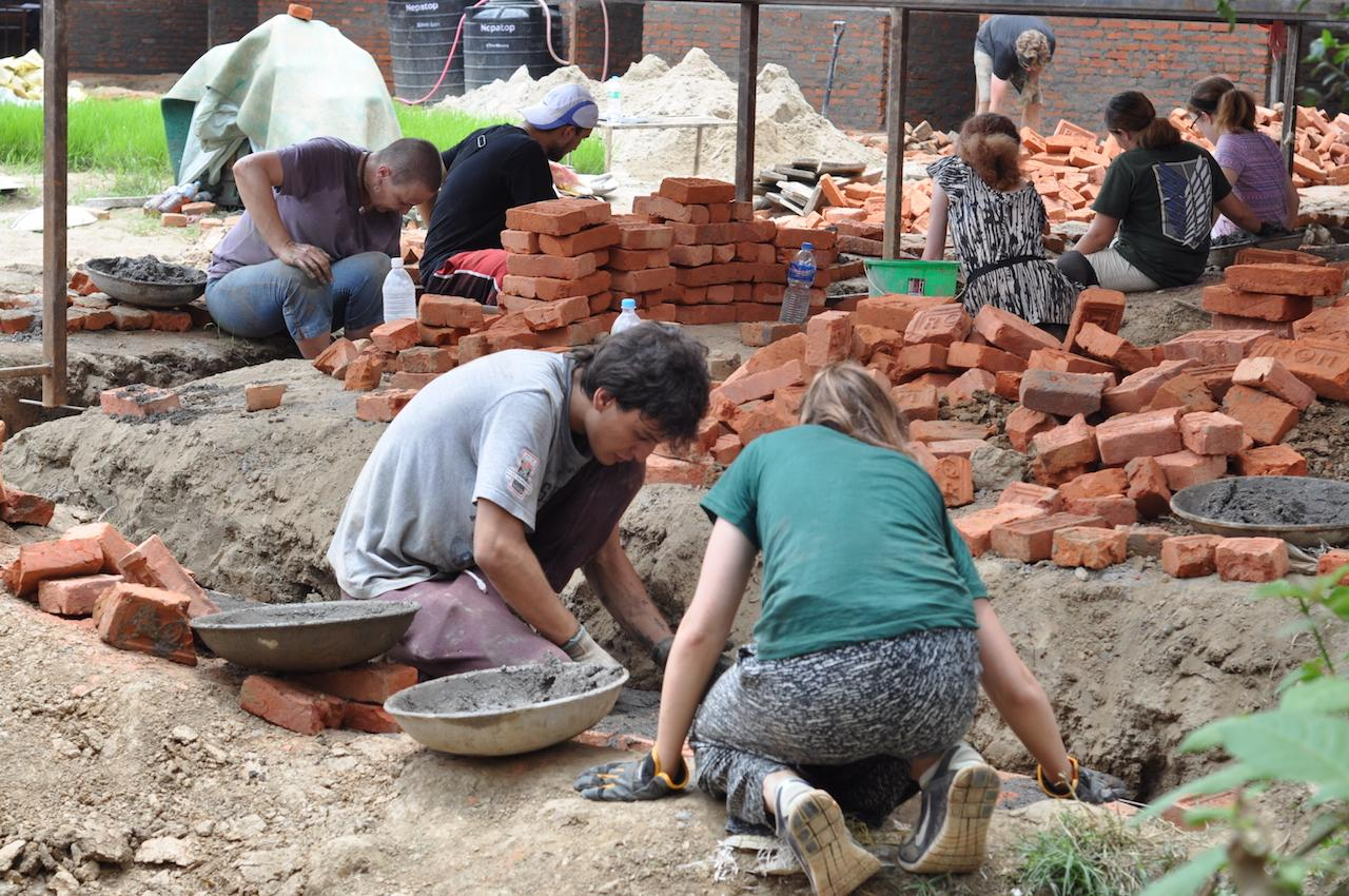 Volunteers with Projects Abroad help to build classrooms during their building volunteer work in Nepal.